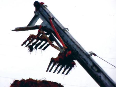 elevatore girevole con doppie forche